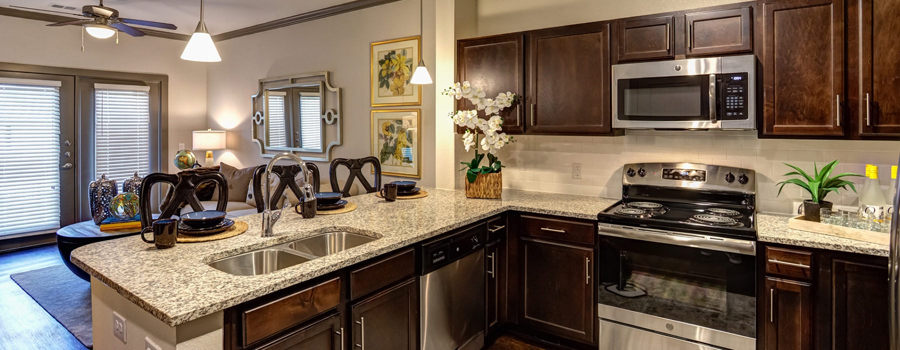 kitchen with stainless steel appliances and granite countertops next to dining area