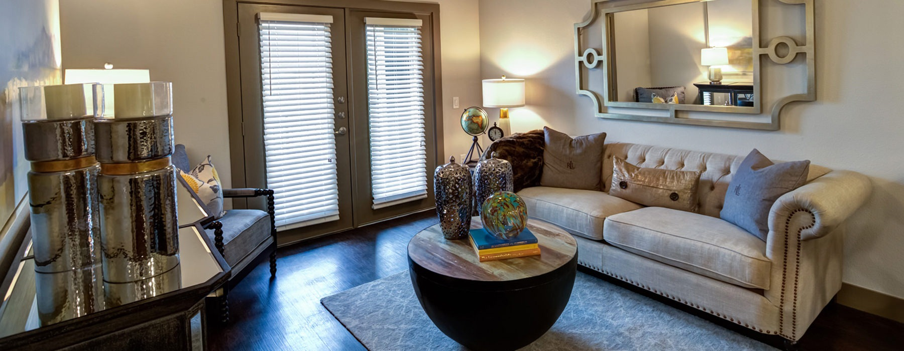 living room with wood floors, comfortable seating and doors that lead to a patio